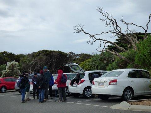 Group huddling by thte cars - Katmun Loh
